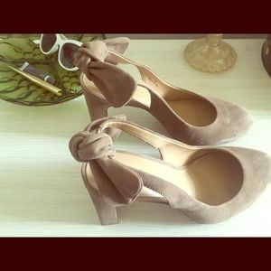 Nude/beige leather suede strap back heels.